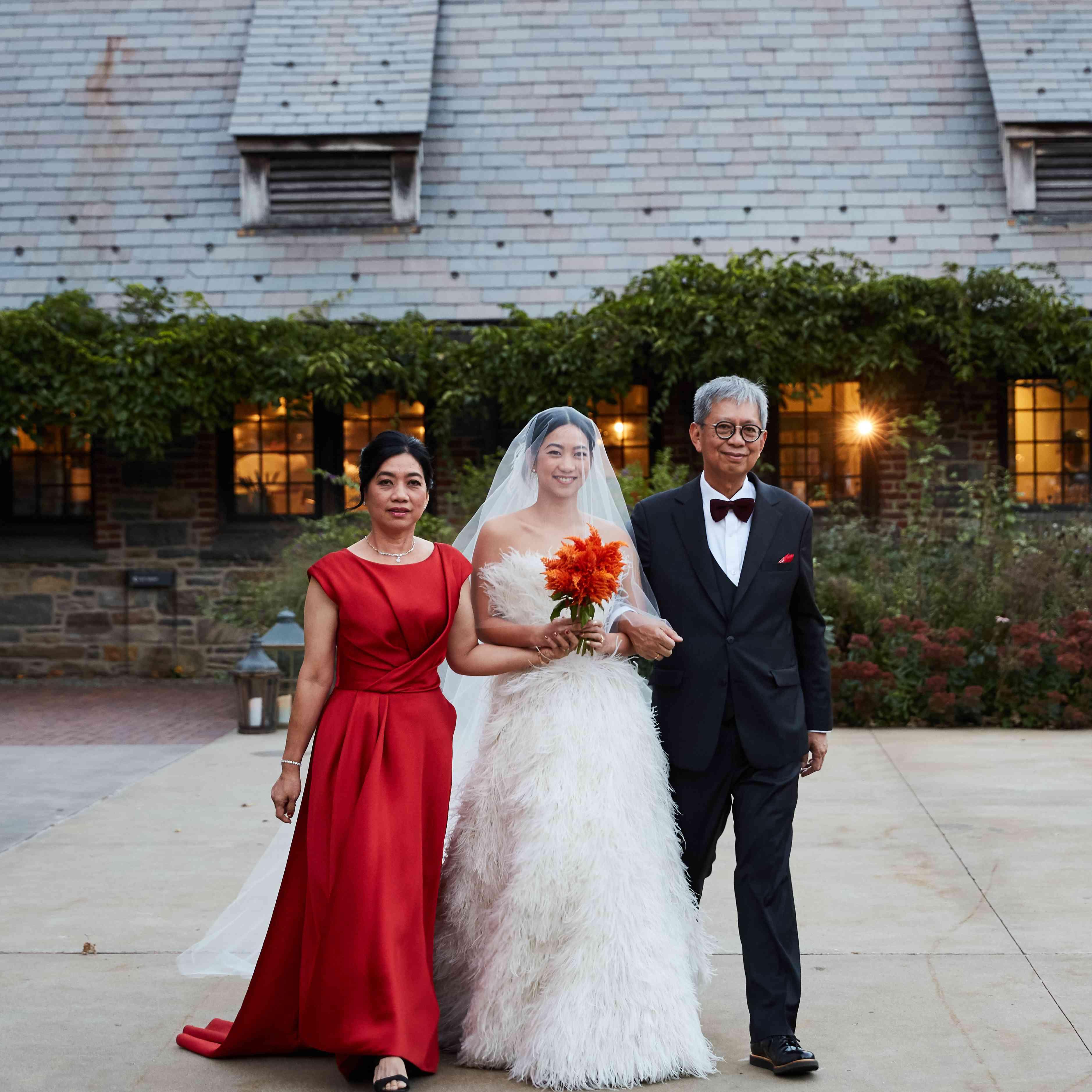 <p>parents walking bride down aisle</p><br><br>