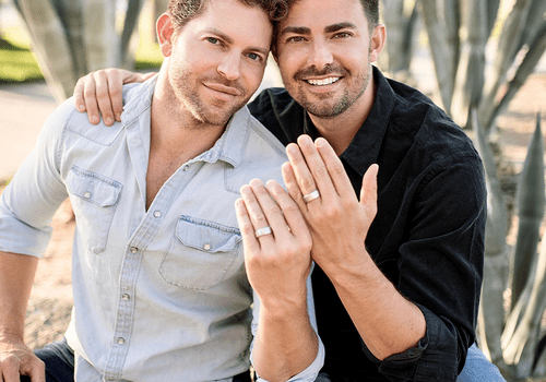 Couple wearing engagement rings