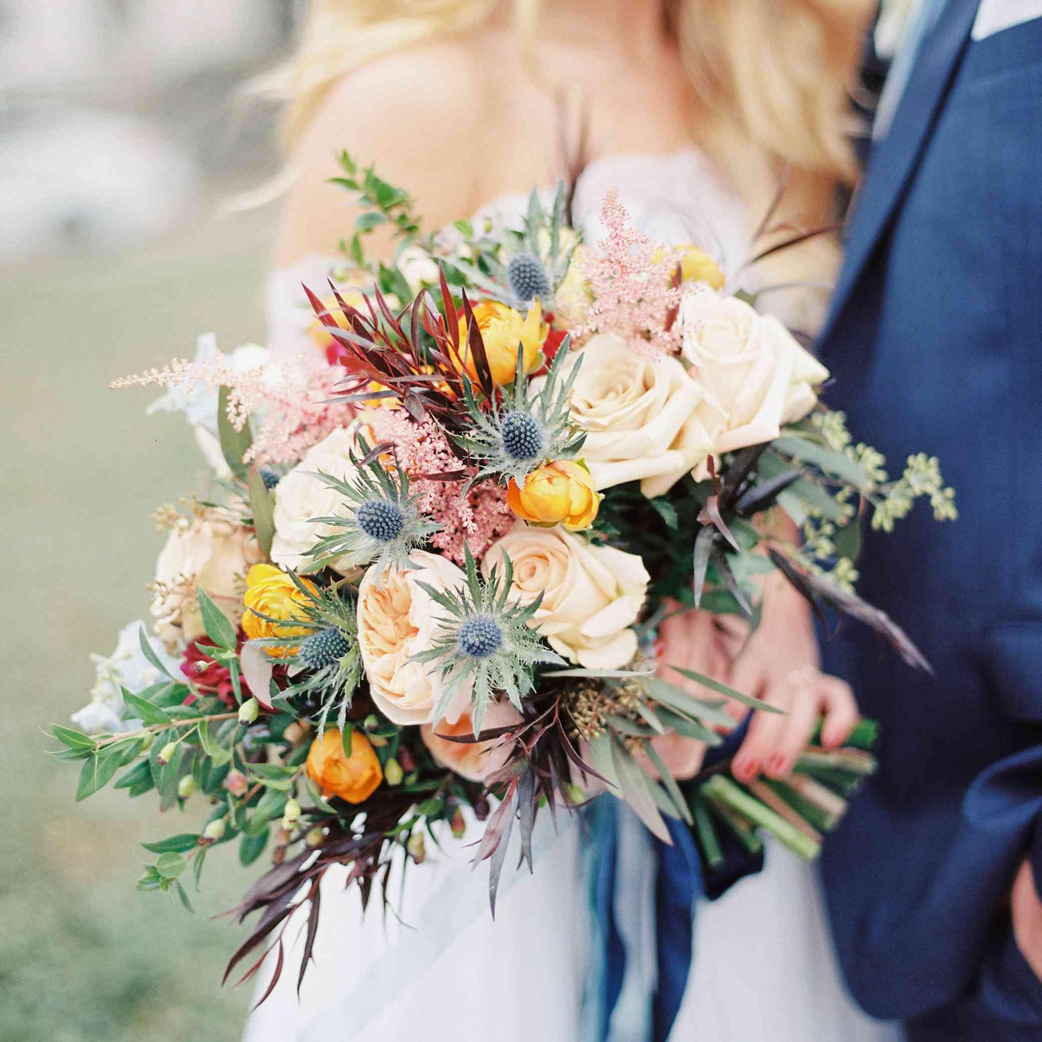 whimsical savannah wedding, bride holding textured fall bouquet