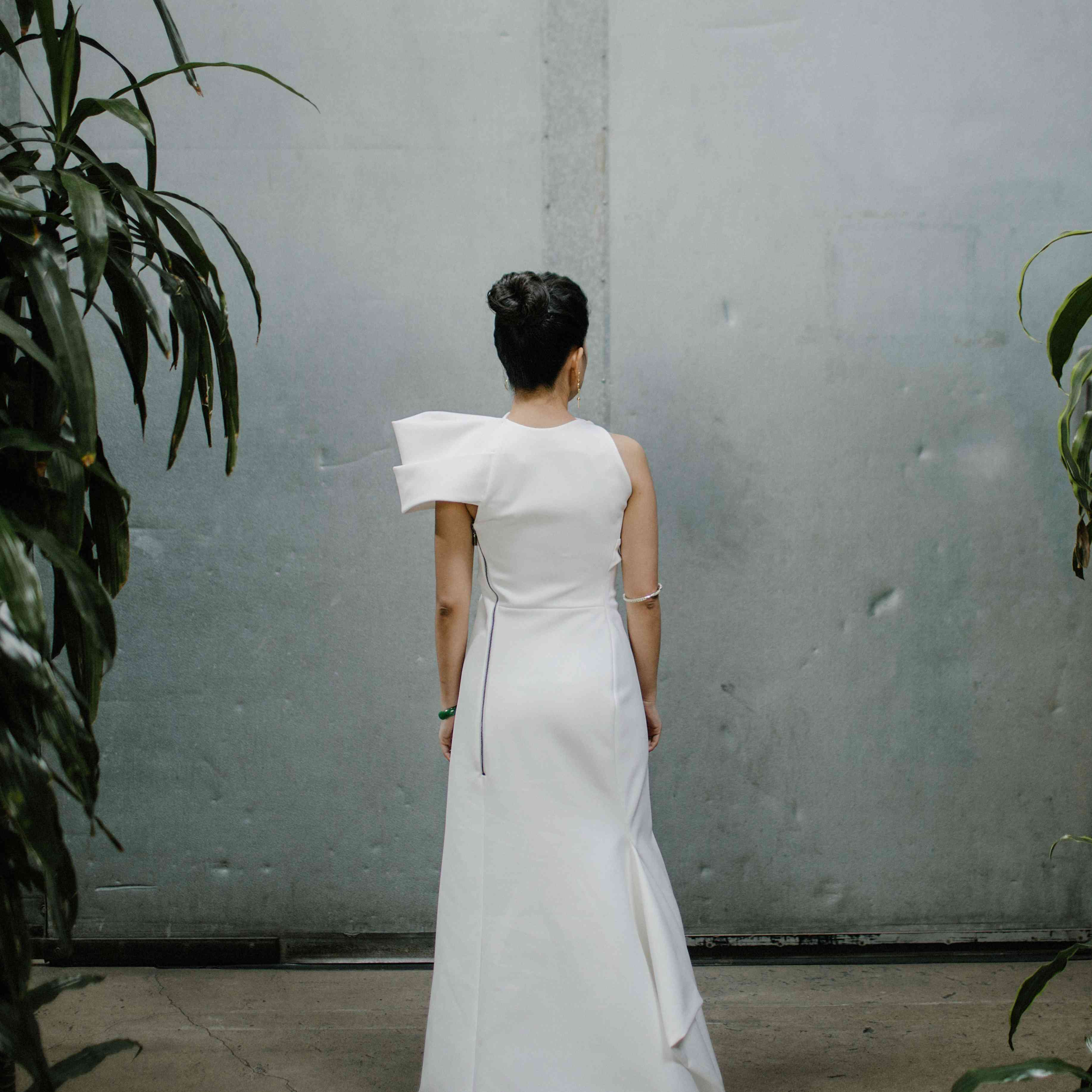 <p>Bride shot from behind</p><br><br>