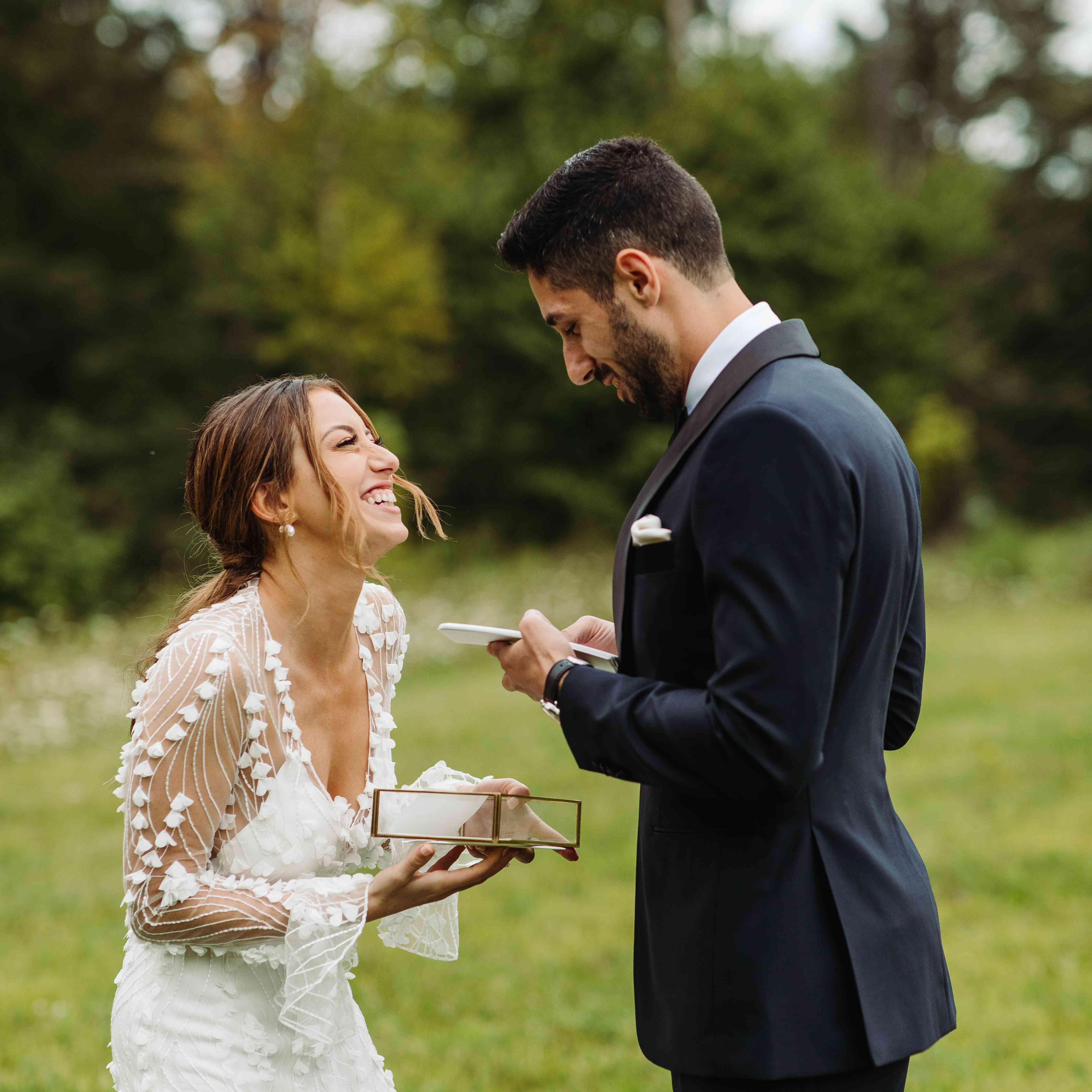 bride and groom exchanging wedding gifts