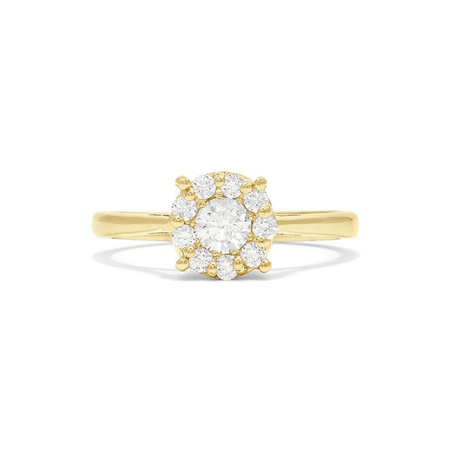 Halo diamond engagement ring with yellow gold band on a white background.