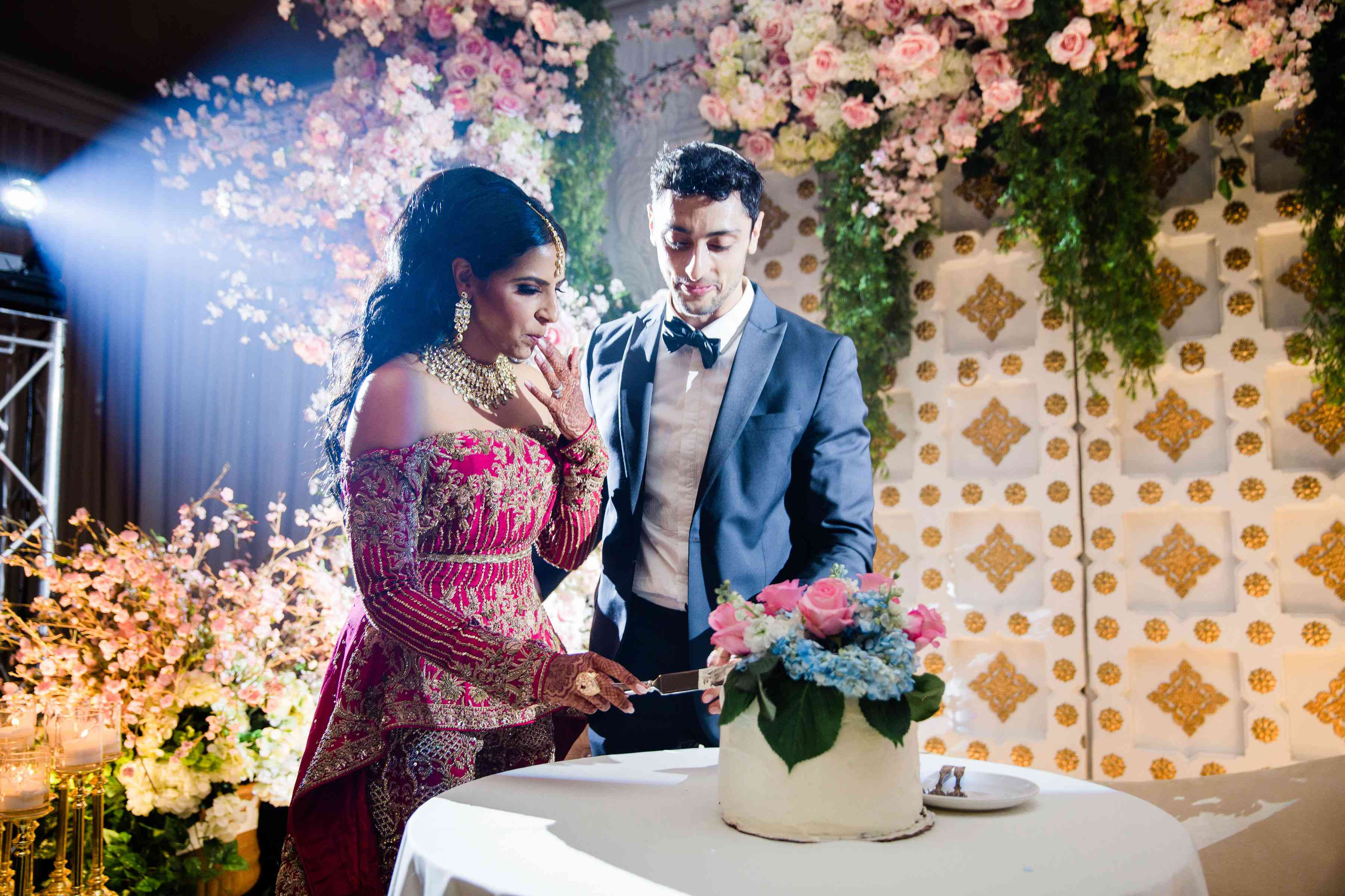 Newlyweds cutting cake