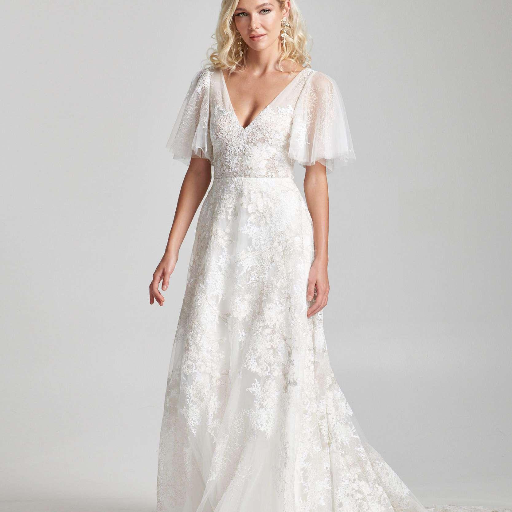 Model in short-sleeve V-neck floral wedding dress