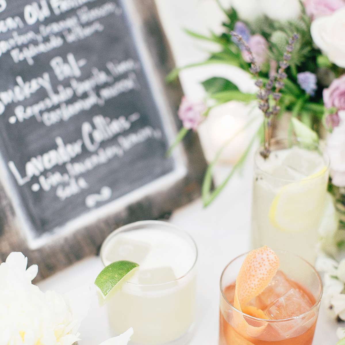 cocktails in front of a chalkboard menu