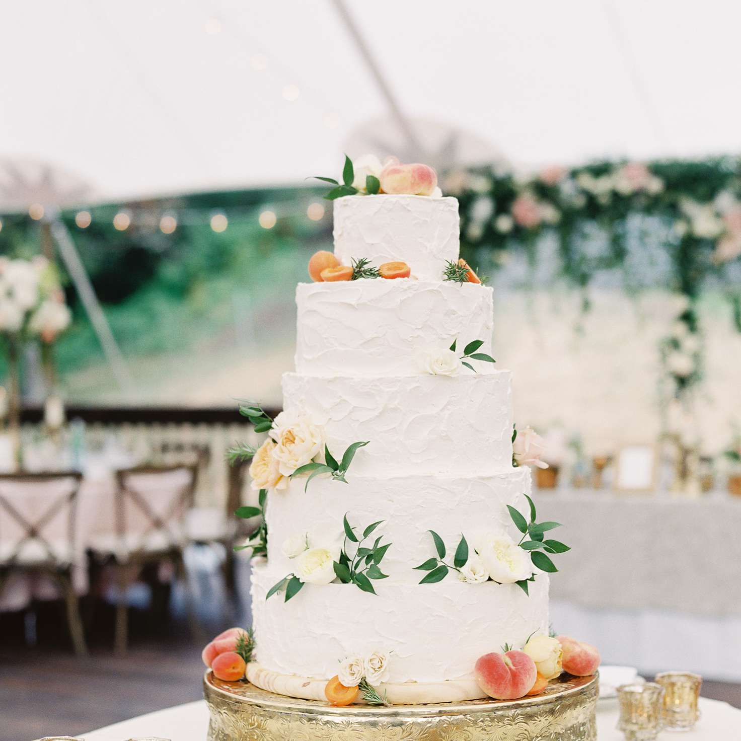 Five-Tiered White Wedding Cake with Flowers and Fruit