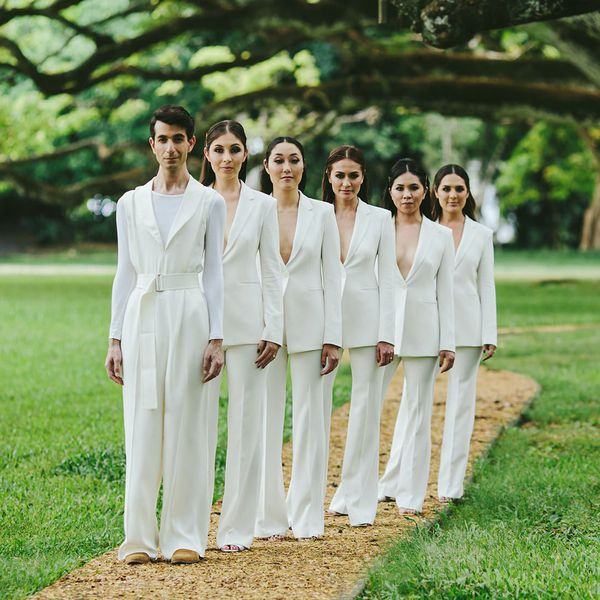 women and man in white
