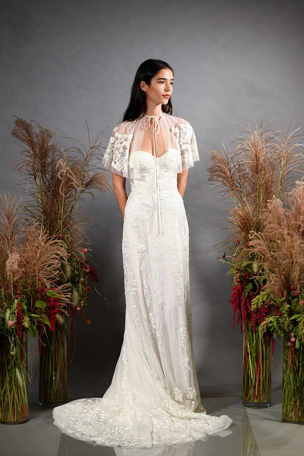 Model in strapless wedding dress with capelet