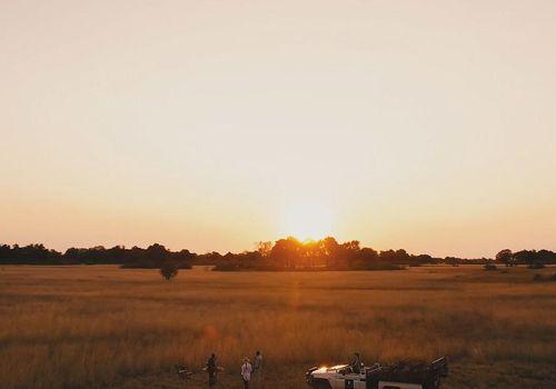 A couple on safari in Botswana's Okavango Delta at Sanctuary Chief's Camp.