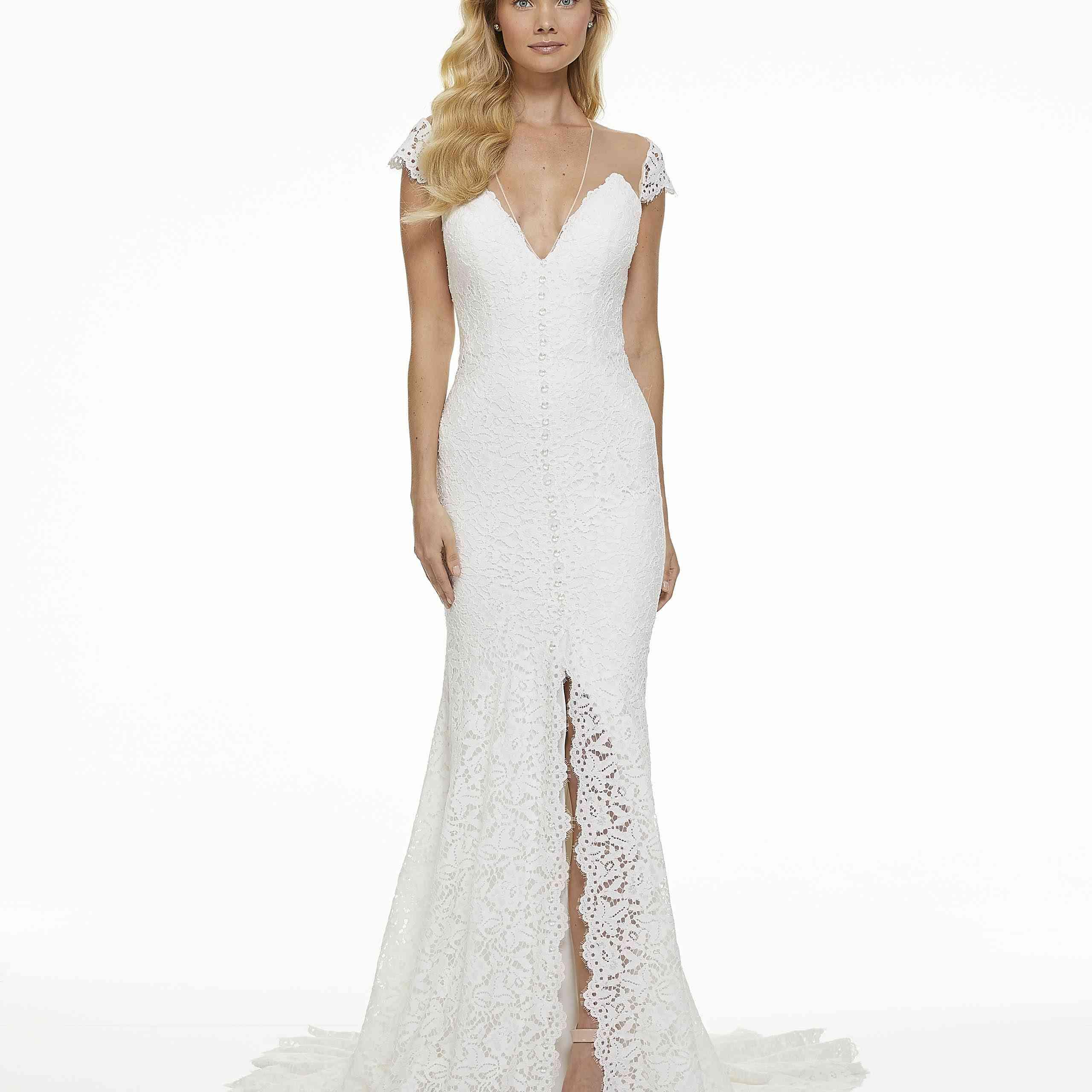 Model in lace cap sleeve wedding dress