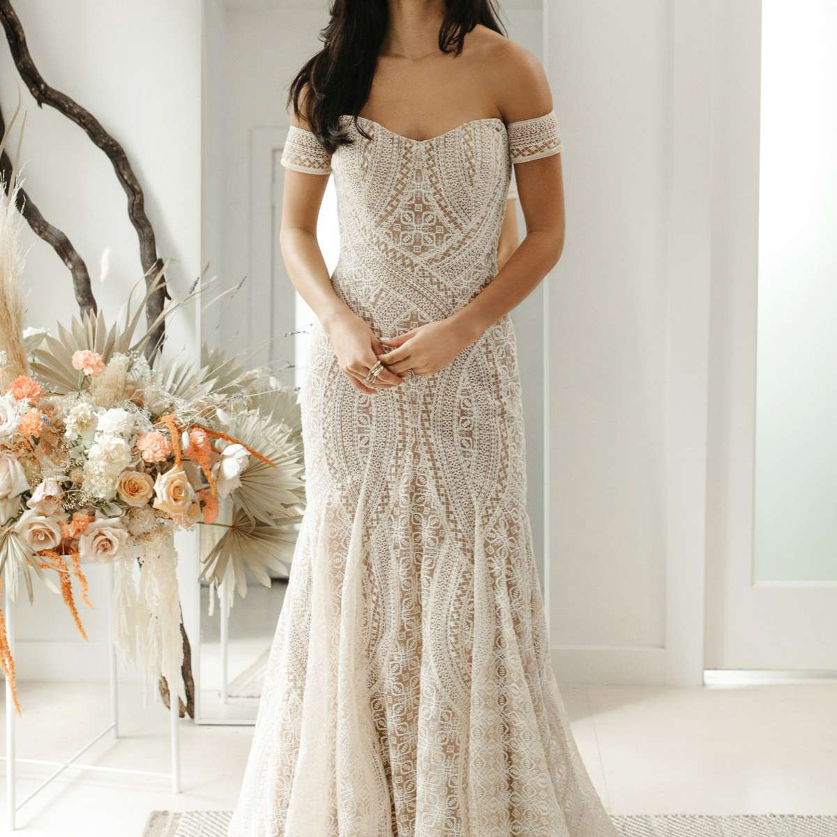 Model in strapless fit-and-flare embroidered gown with matching armbands
