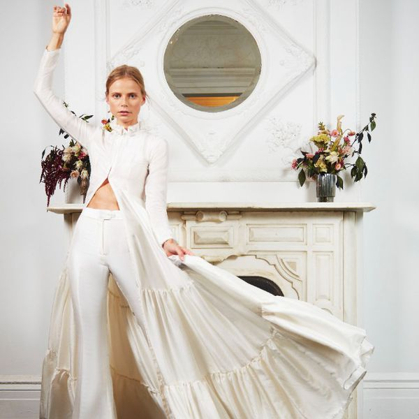 Model in silk caftan with flare trousers
