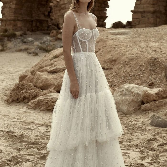 31 Beach Wedding Dresses Perfect For A Seaside Ceremony