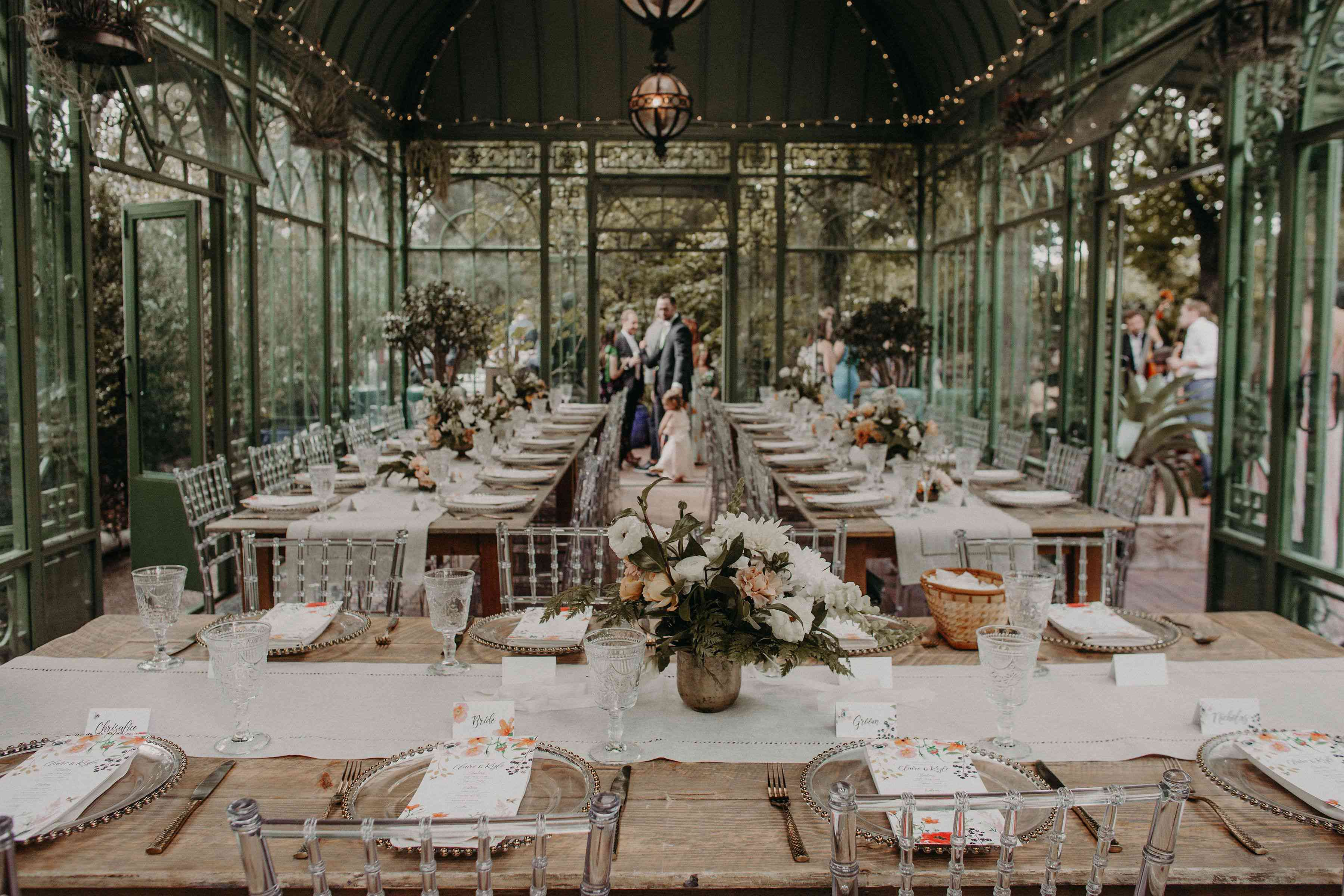 Reception inside a solarium with flowers and twinkle lights