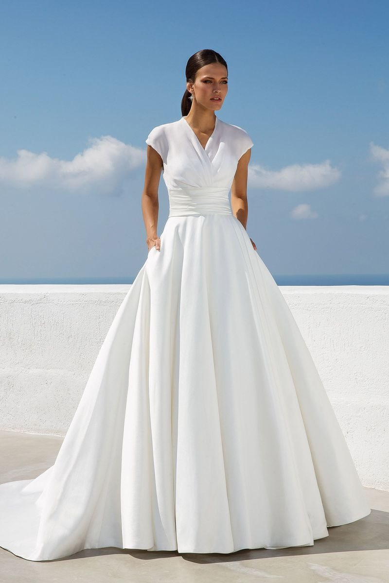 Model in sleeved white bridal gown with pockets