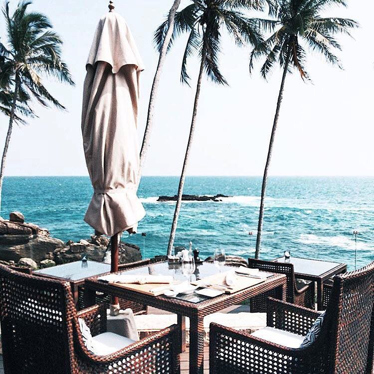A table overlooking the ocean at Anantara Peace Haven Tangalle Resort in Sri Lanka.