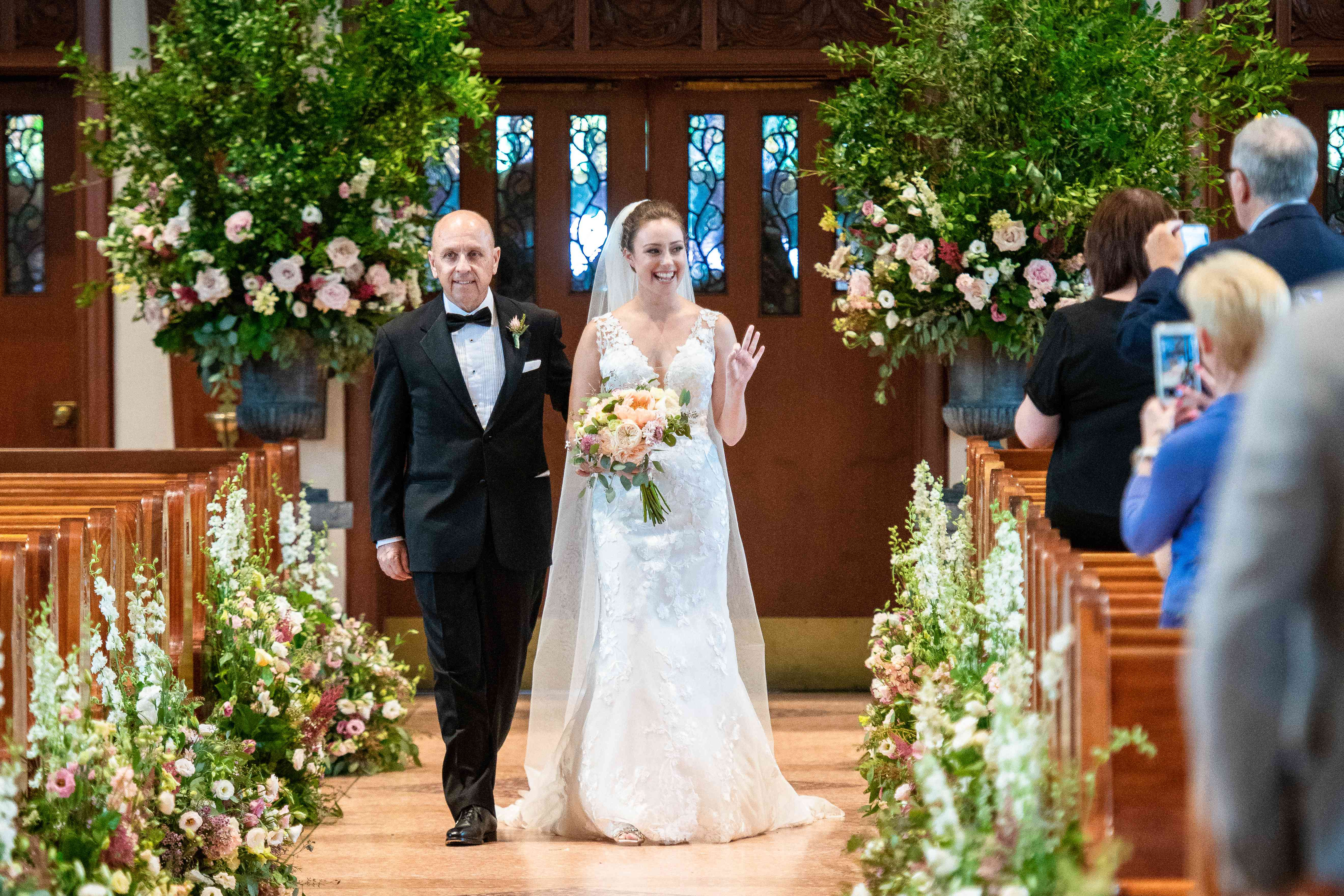 <p>bride and father of the bride walking down aisle</p><br><br>