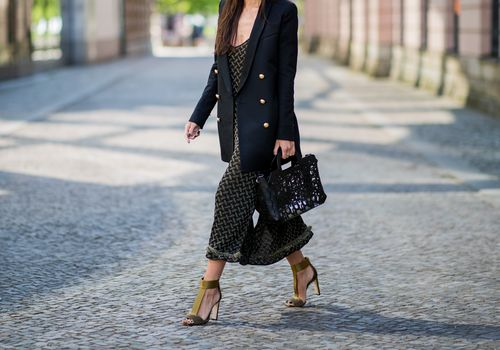 a business woman crossing the street