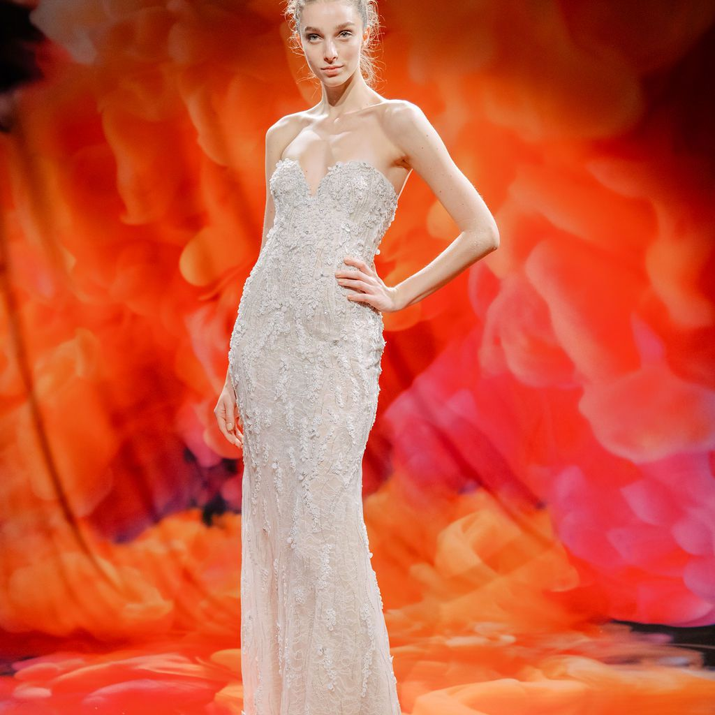 Model in embroidered strapless wedding gown