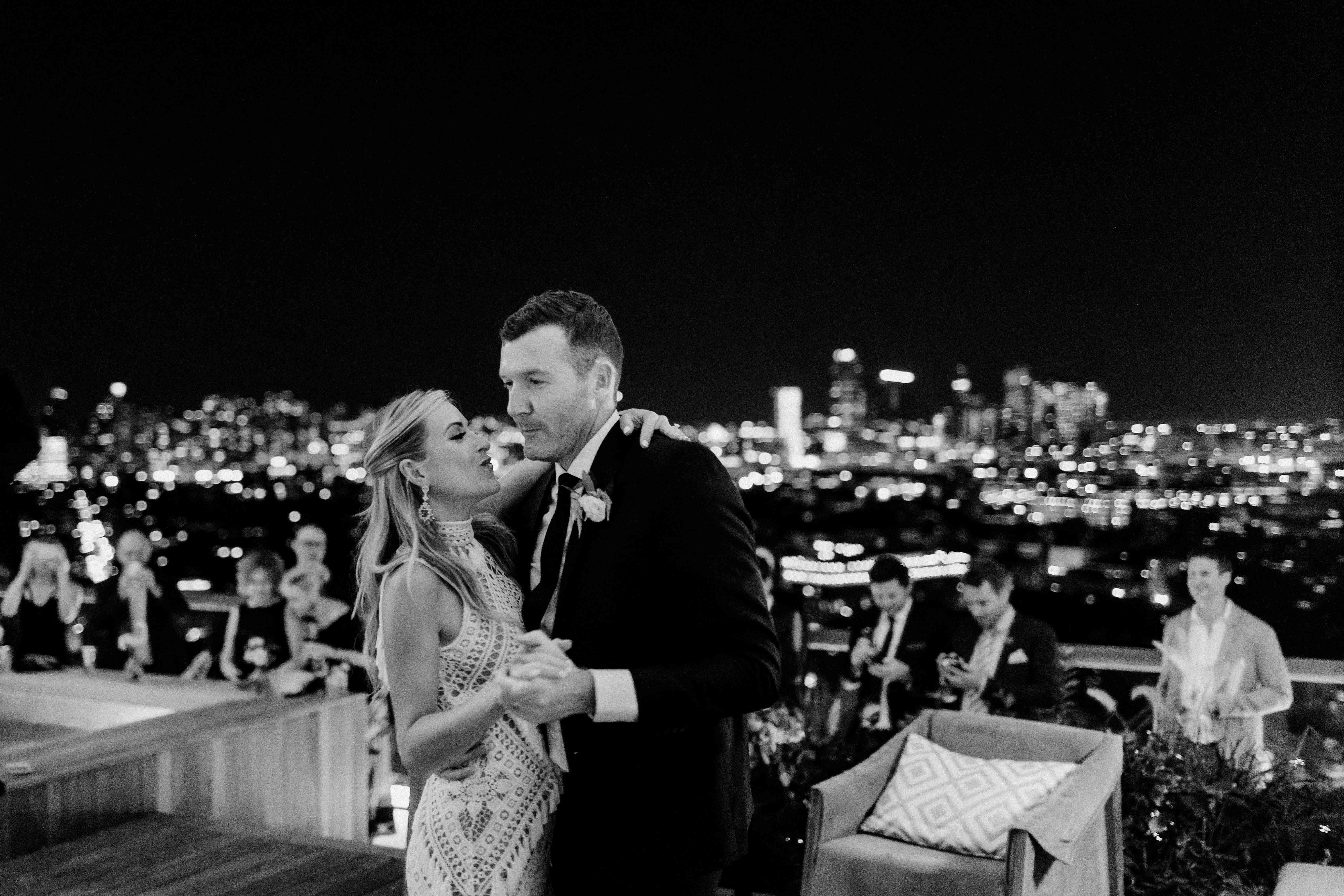 Couple dancing behind skyline