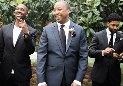 Groomsmen laughing together with groom