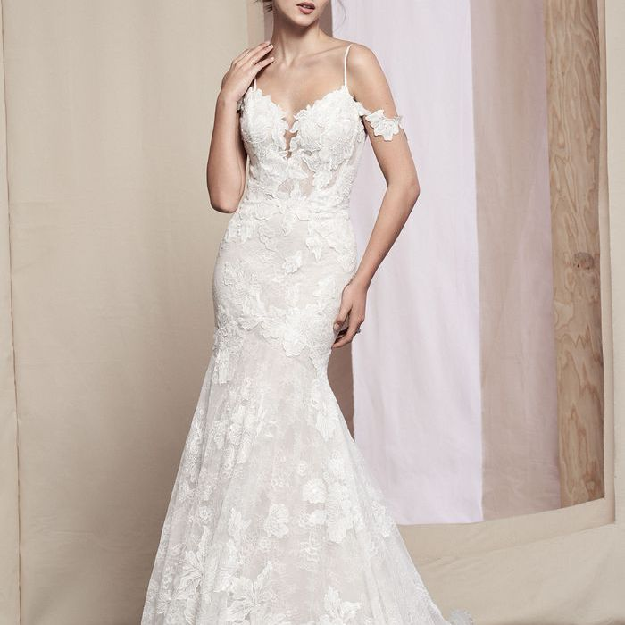 Model in off-the-shoulder fit and flare floral wedding gown
