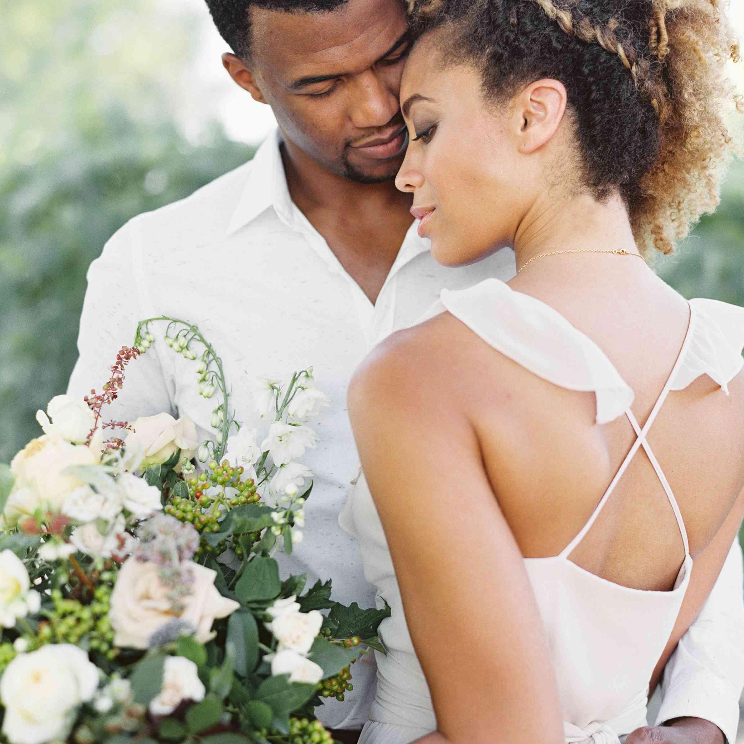 Braided updo natural hair wedding couple