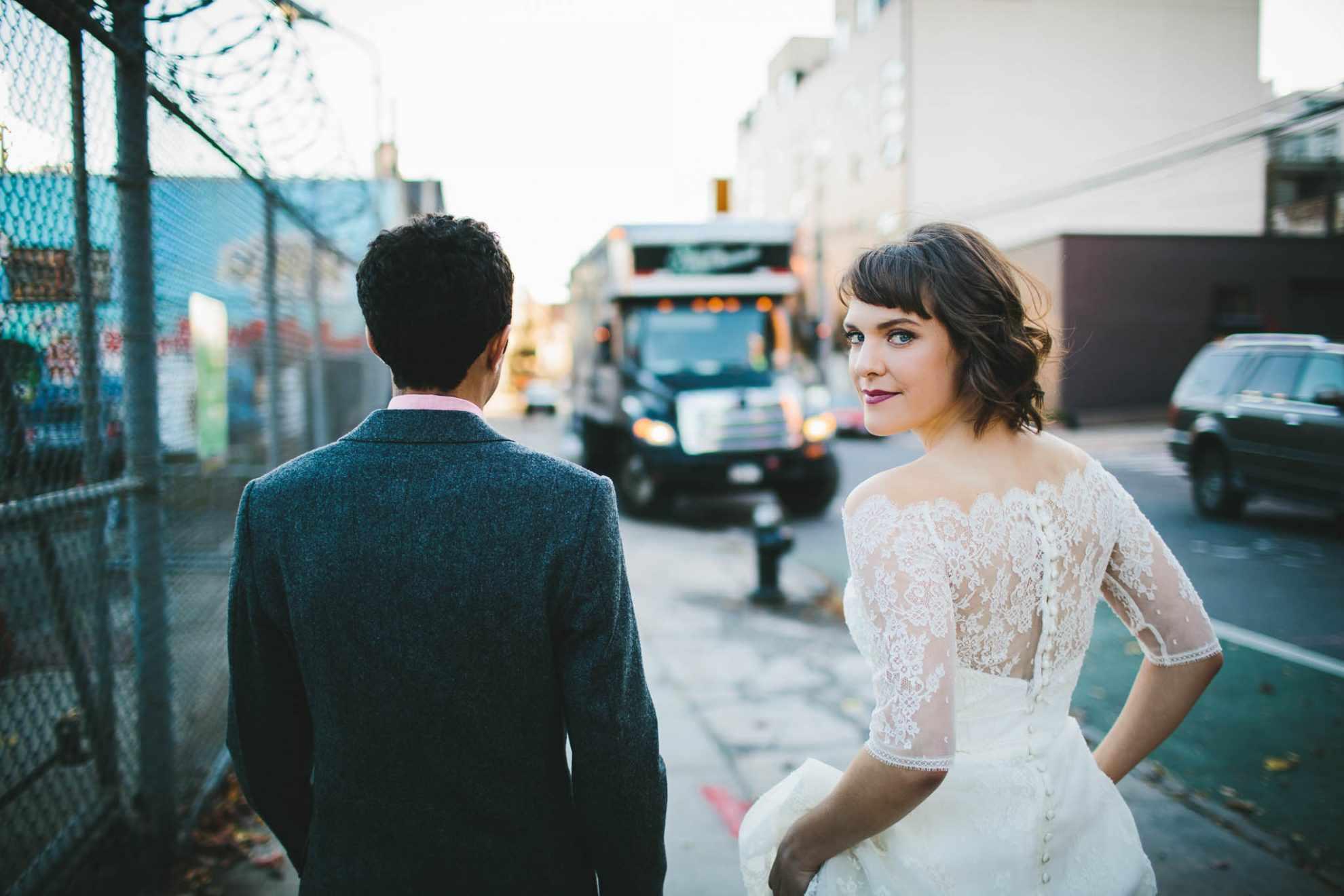 bride and groom walking in an urban destination