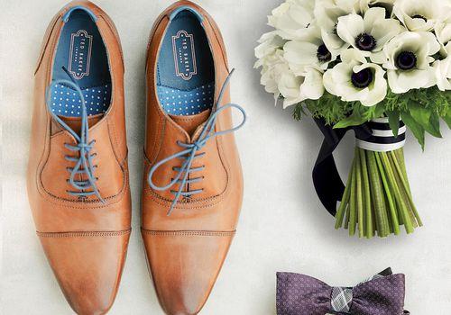 men's shoes, bowtie and bouquet