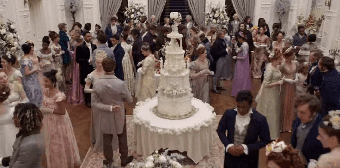 A 4.5-foot-tall wedding cake centerpiece in a crowded room
