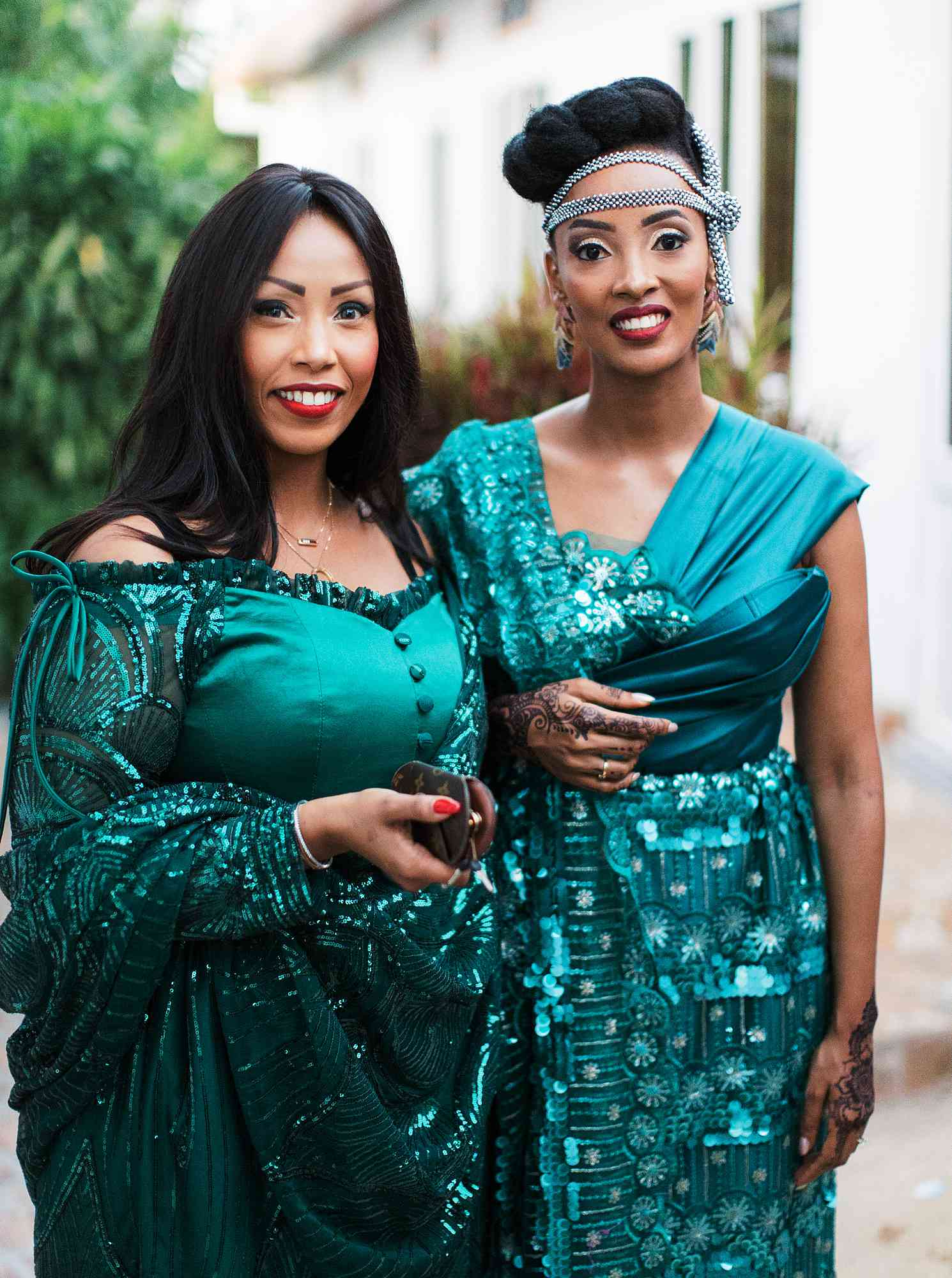 Bride and bridesmaid in emerald green