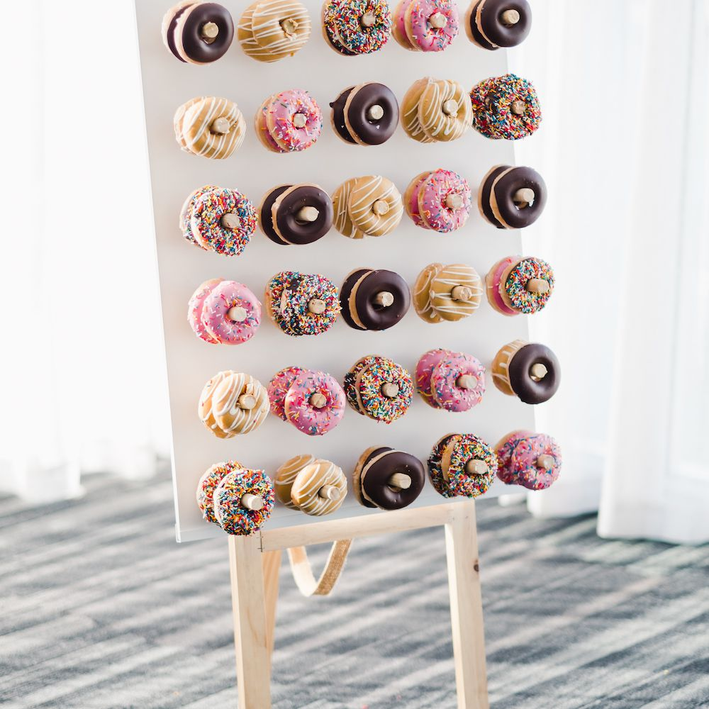 Donut wall featuring a mix of sprinkle and icing-coated donuts