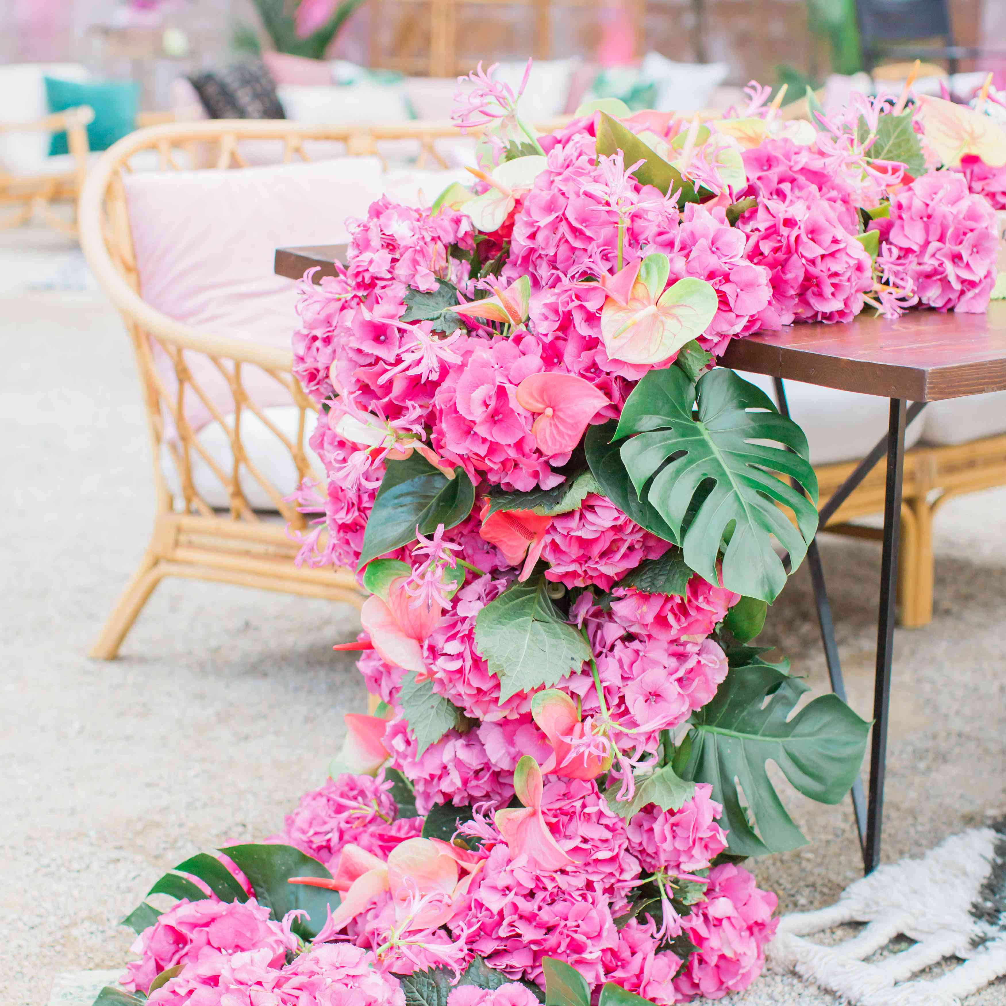 Floral garland of pink hydrangeas and palm fronds