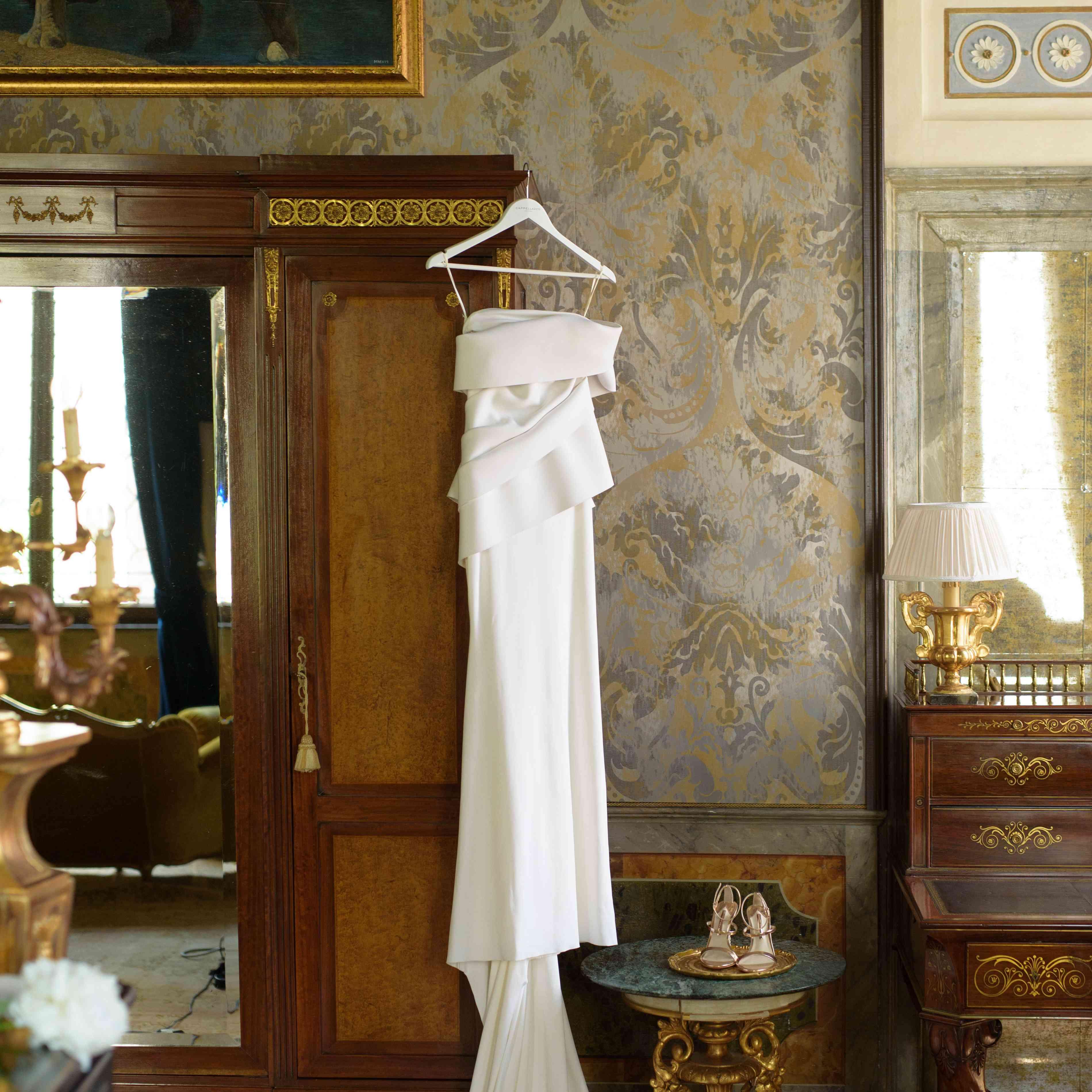 modern venice wedding, bride's dress hanging