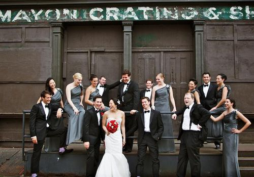 Wedding party in front of industrial building