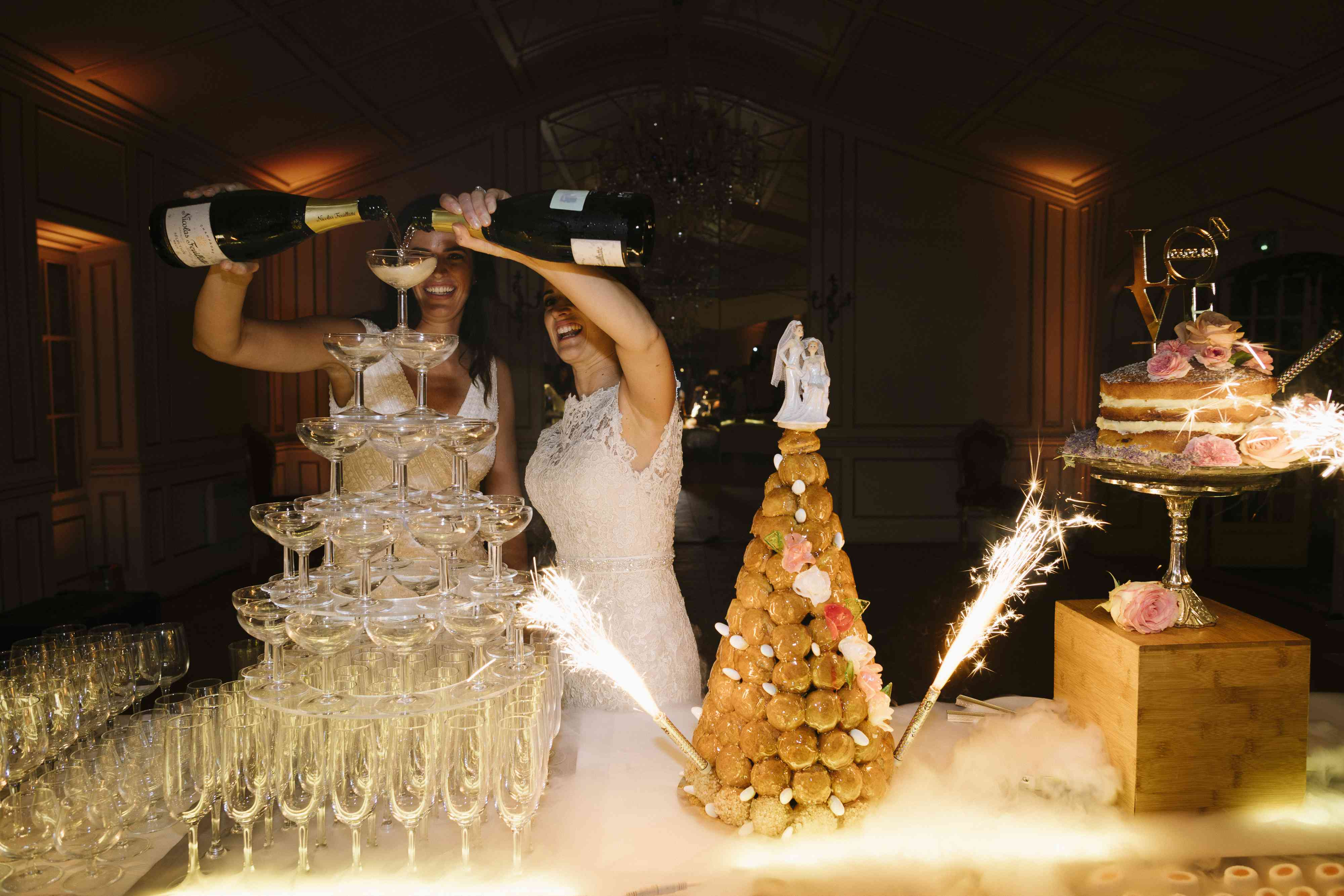 <p>brides pouring reception champagne tower</p><br><br>