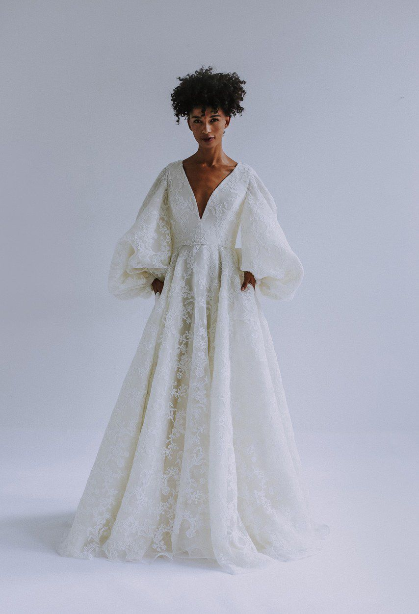 V-neck white embroidered wedding gown with puffy sleeves
