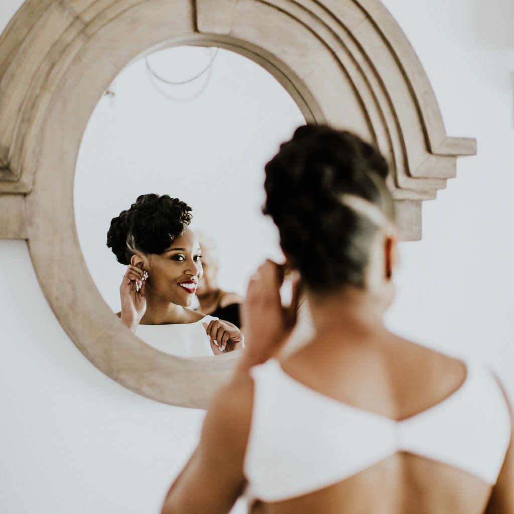 <p>bride trying on earrings</p><br><br>