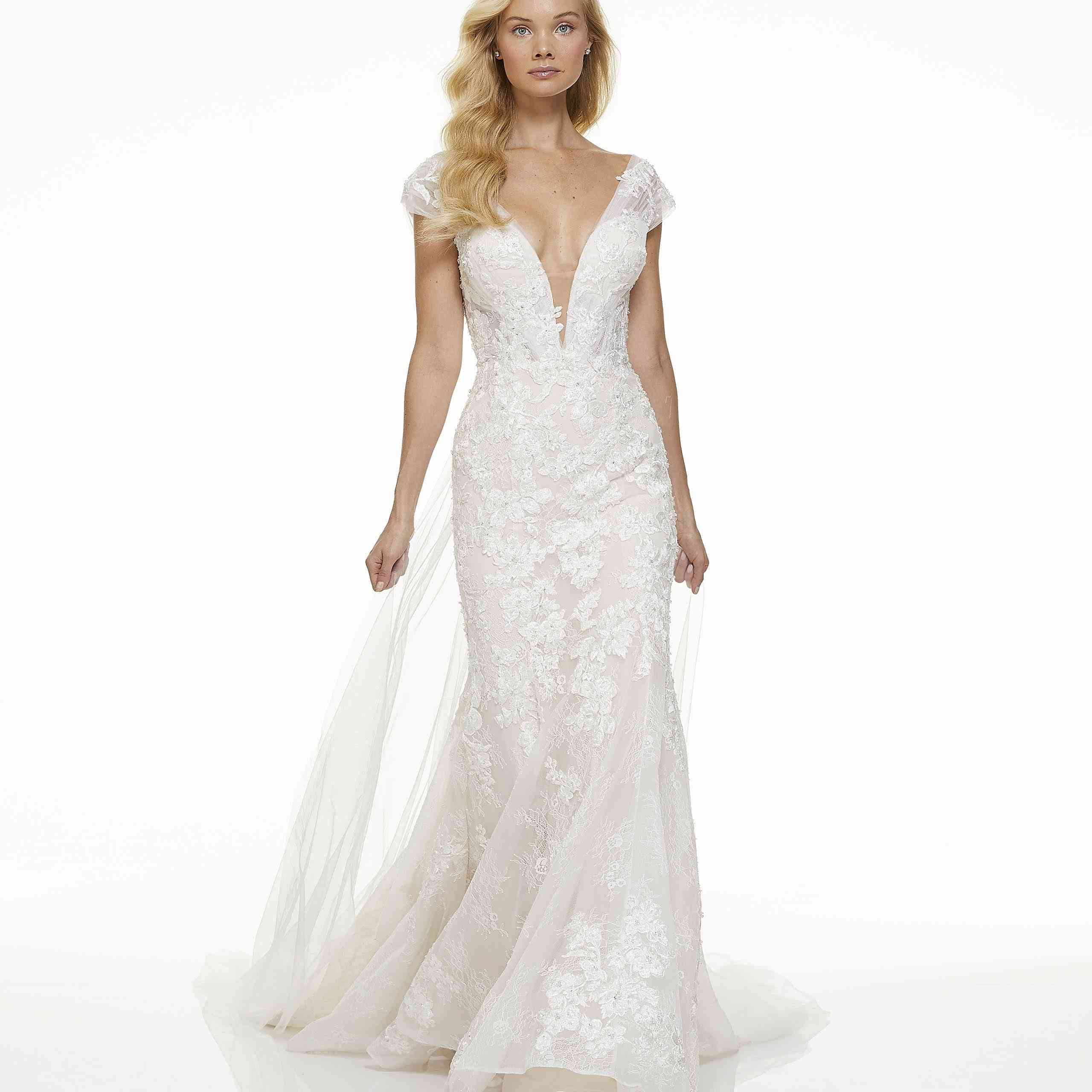 Model in plunging fit-and-flare wedding dress