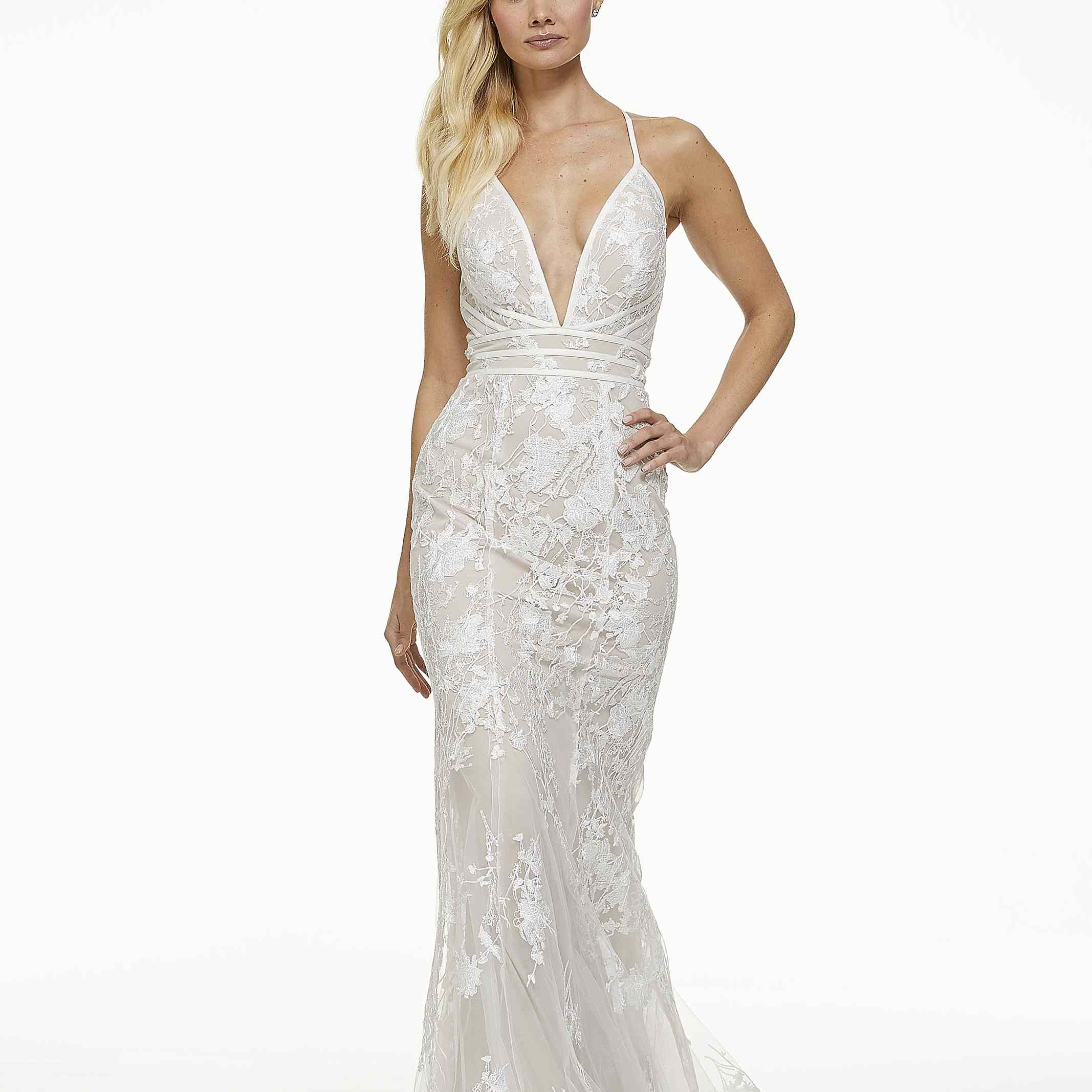 Model in fit-and-flare wedding dress with plunging neckline