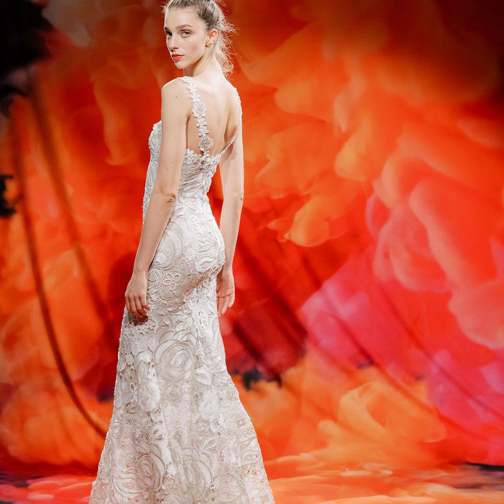 Model in allover lace wedding gown