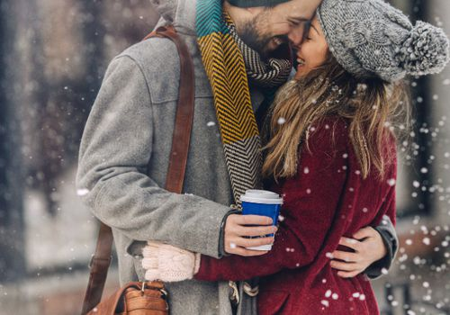 Couple embracing in the snow