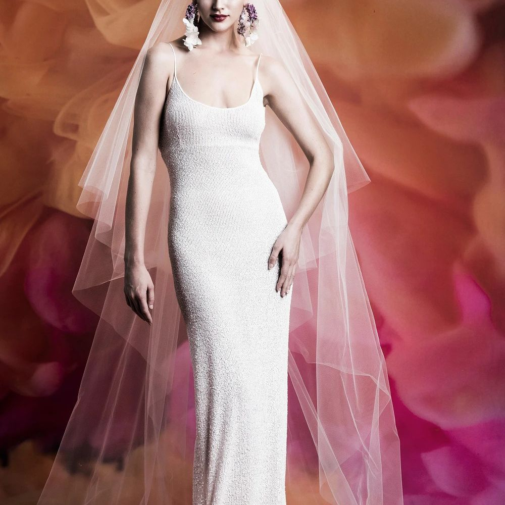 Model in fitted thin-strap sparkling scoop-neck gown