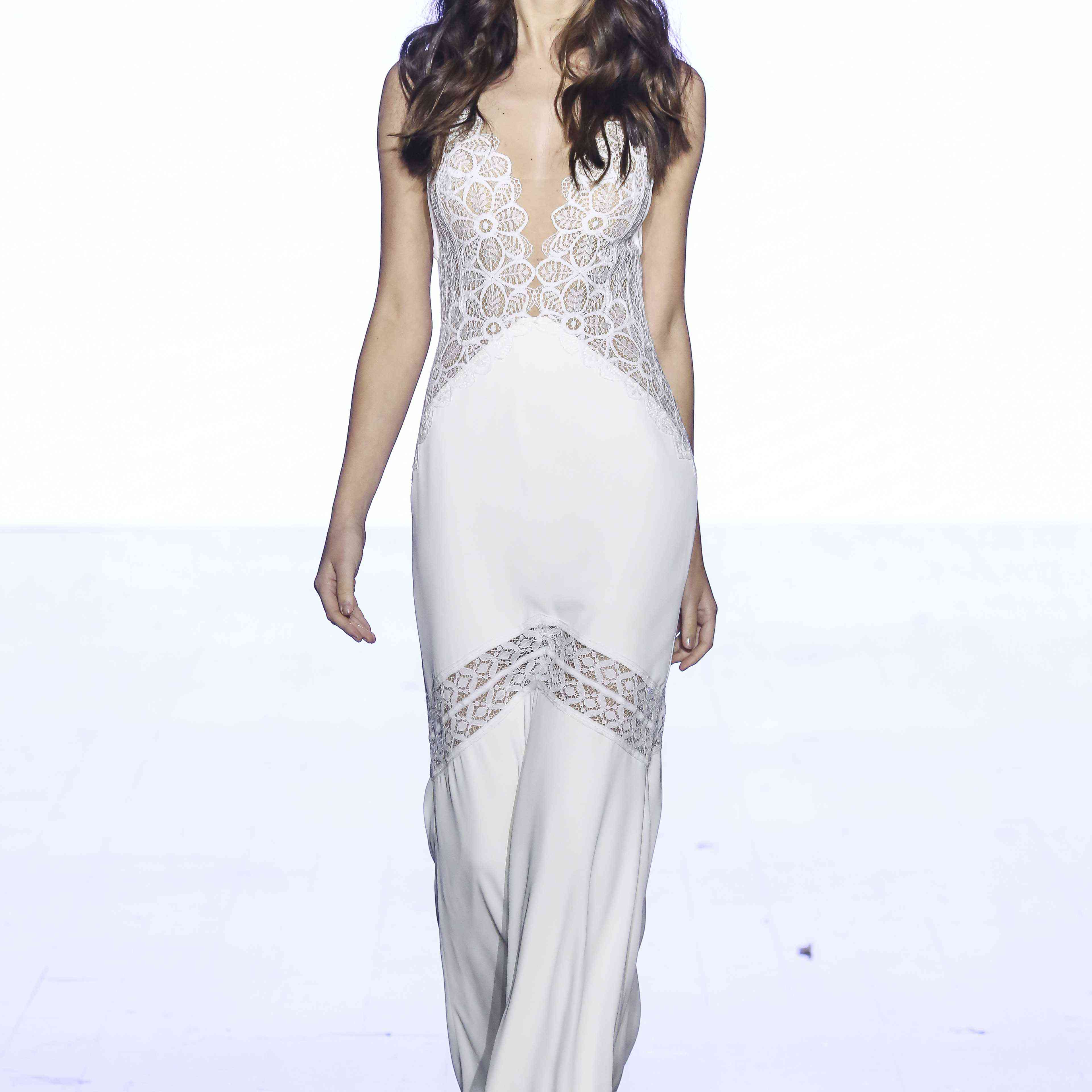 Model in a lace and georgette sheath gown with a plunging illusion bodice