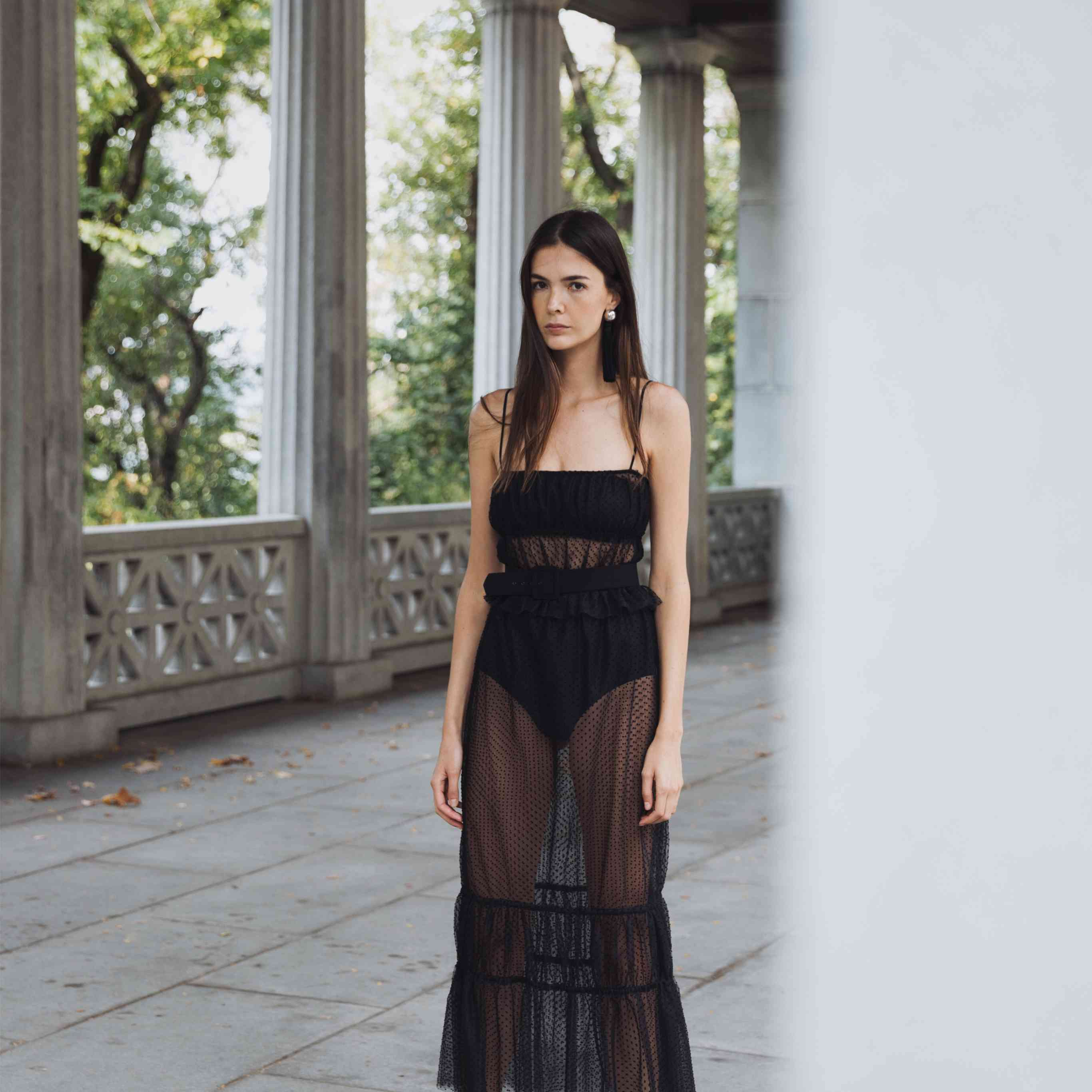 Model in black see-through wedding top and skirt