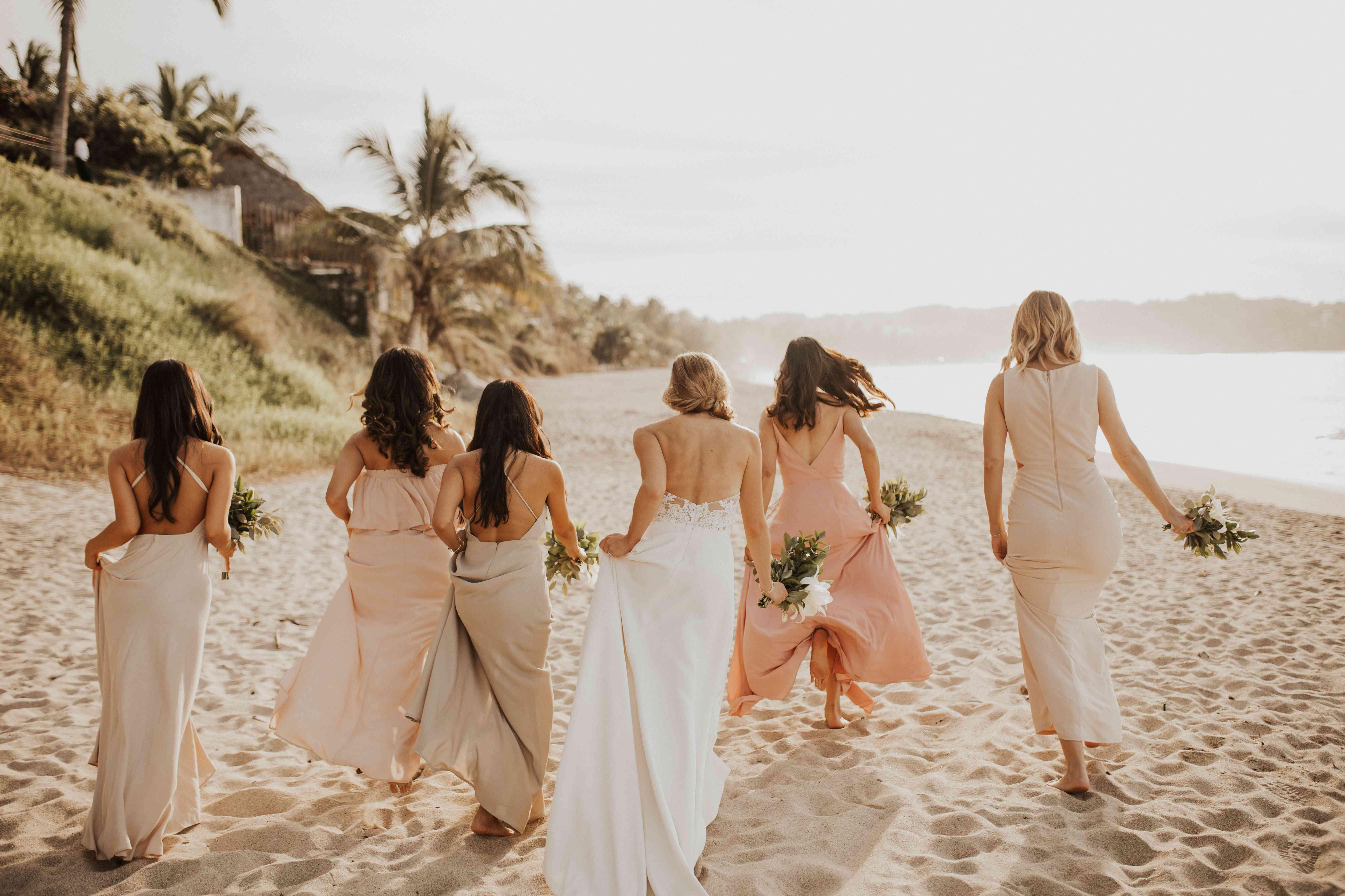 <p>Brides running down beach</p><br><br>