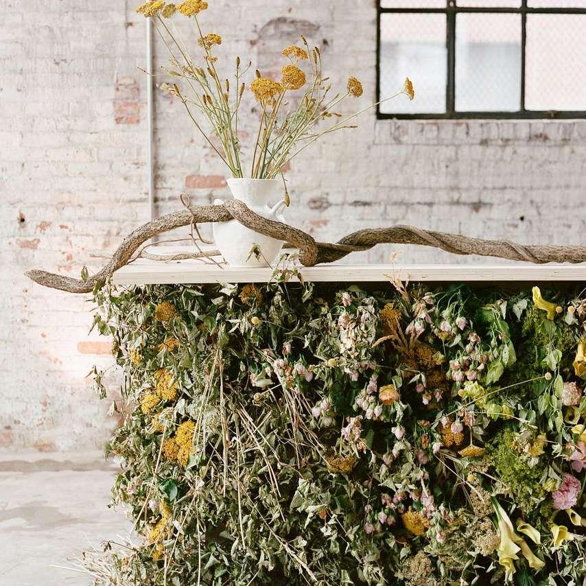 Floral and vine embellished bar