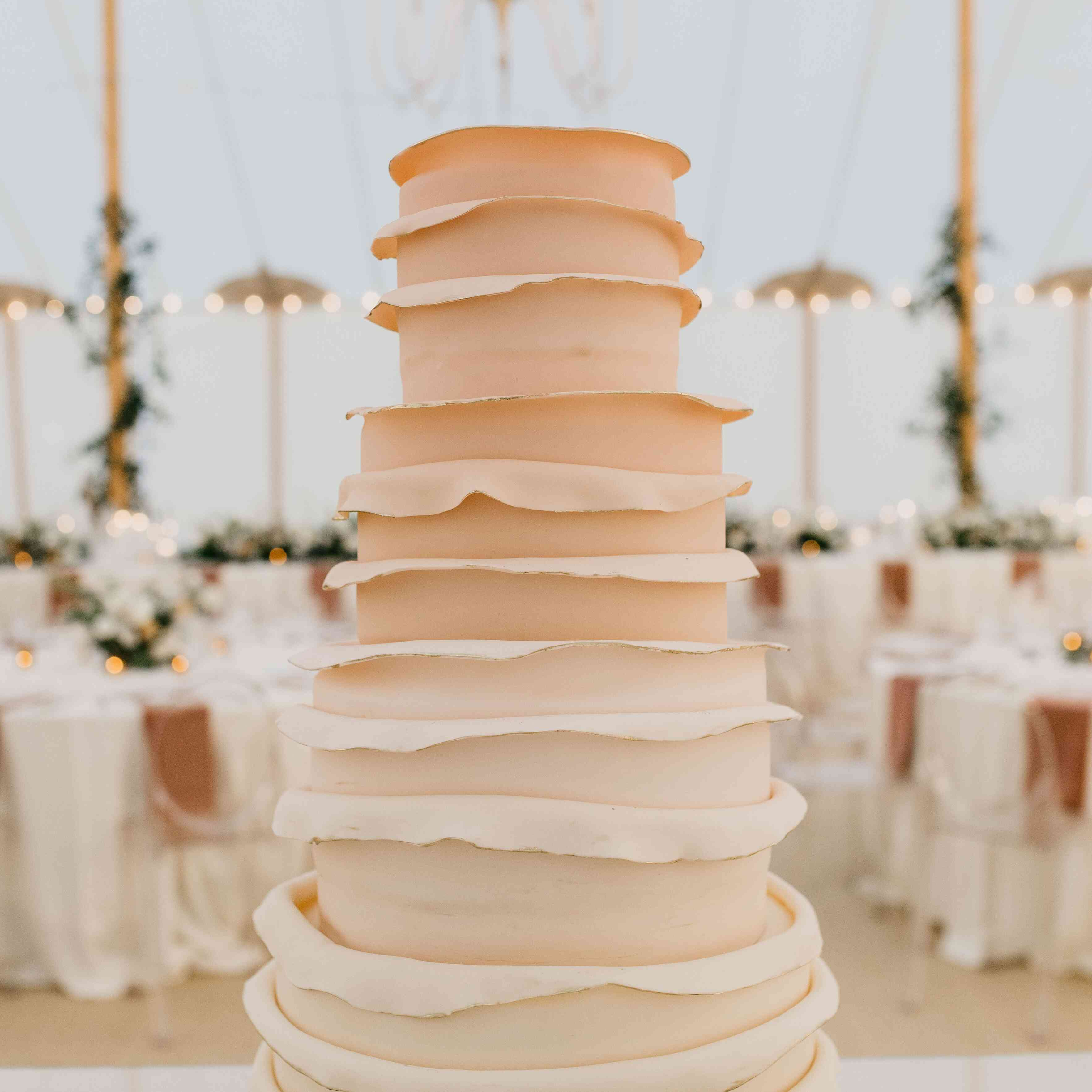 Peach ombre four-tier ruffle layered wedding cake