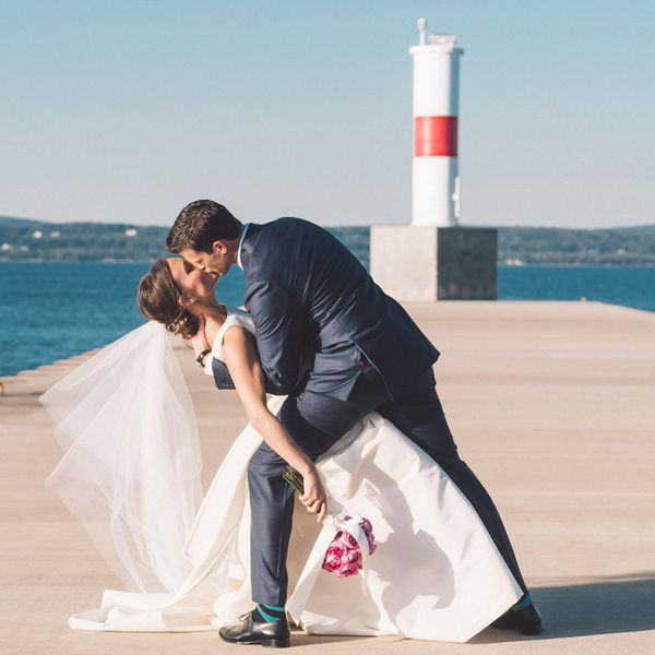 Bride and Groom Kissing on Dock