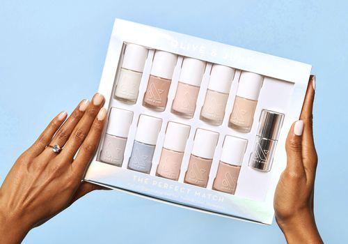 hands holding nail polish box